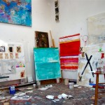 Inside of the studio with paintings